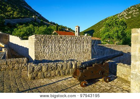 Old Gun In Ston