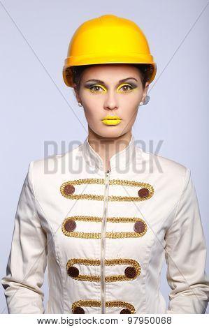 Beautiful girl with yellow helmet portrait