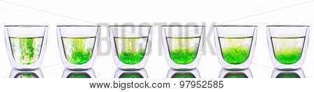 Green color spread in glass of water