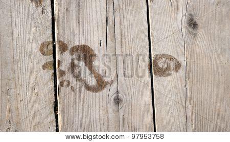 Footprint On Wooden Floor