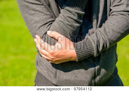 Man Holding His Elbow Arthritic Closeup