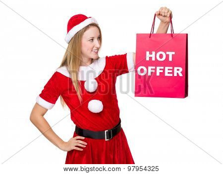 Christmas woman hold with shopping bag showing hot offer