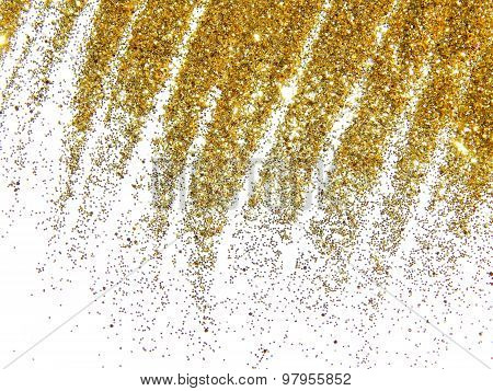 Golden glitter sparkle like a golden rain on white background