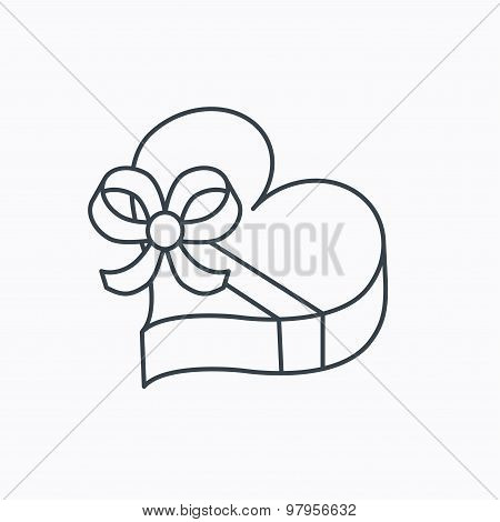 Love gift box icon. Heart with bow sign.