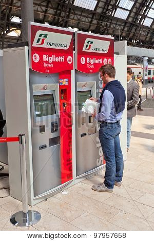 Man Using Ticket Machine In Milan, Italy