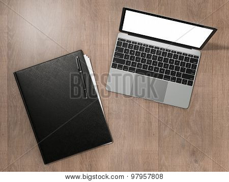 Folder For Papers And Laptop On A Wooden Texture