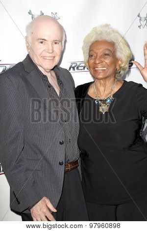 LOS ANGELES, CA - AUGUST 1: Walter Koenig and Nichells Nichols arrive at the premiere of Star Trek: Renegades at the Crest Theatre on August 1, 2015 in Los Angeles, CA.