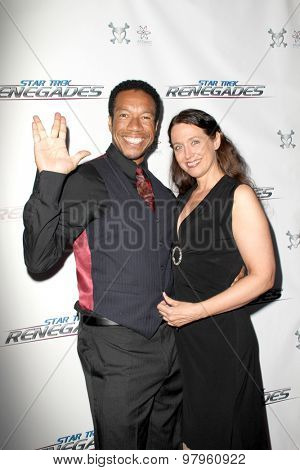 LOS ANGELES, CA - AUGUST 1: Rico E. Anderson and guest arrives at the premiere of Star Trek: Renegades at the Crest Theatre on August 1,2015 in Los Angeles, CA.