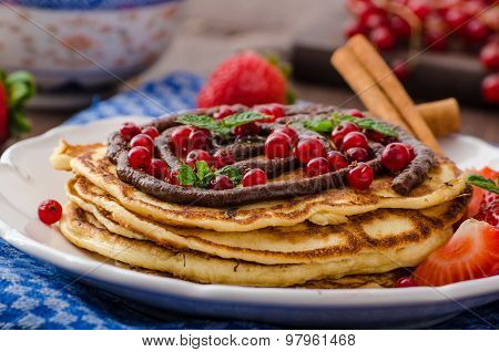 Cinnamon Pancakes With Chocolate Sauce And Berries