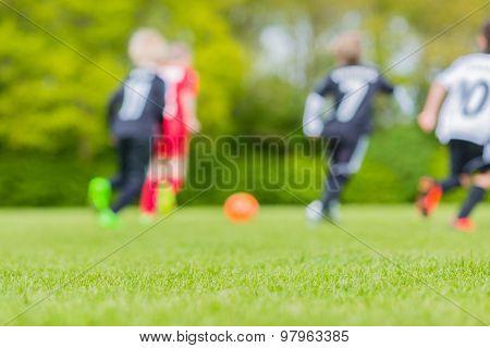 Blur Of Children Playing Soccer