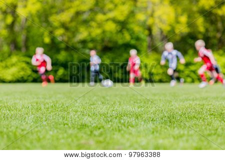 Blur Of Children Playing Soccer