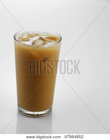Ice coffee in a glass over gray background