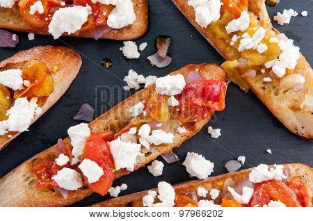 Bruschetta With Tomato, Onion And Goat Cheese