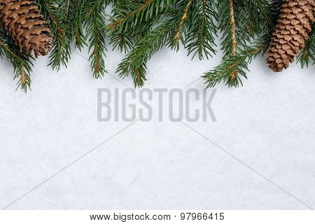 Christmas Background With Fir Branches, Cones And Snow