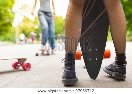 Teenage girl urban long board riding.