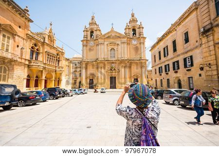 Mdina, Malta - 26 May, 2015: St. Paul's Cathedra on the background of Rabat squarel in the city of Mdina (The city of Silence) in Malta