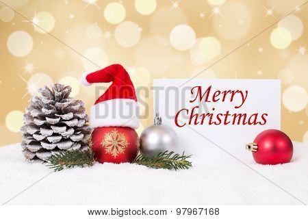 Merry Christmas Card With Ornaments, Golden Background And Hat Decoration