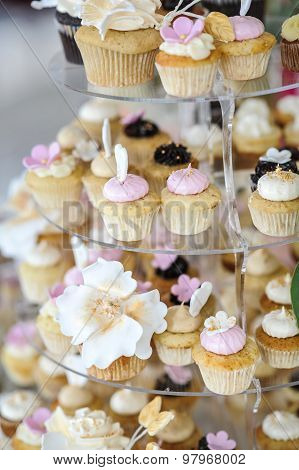 Wedding decoration with pastel colored cupcakes, meringues, muffins and macarons