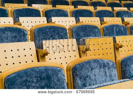 Rows of empty blue seats