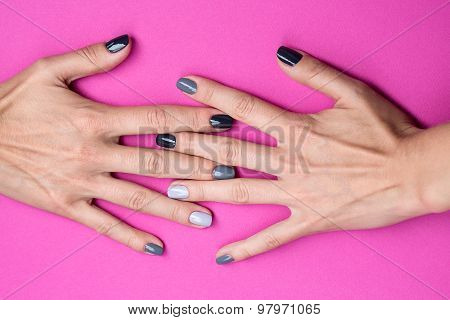 Delicate female hands with a stylish neutral manicure