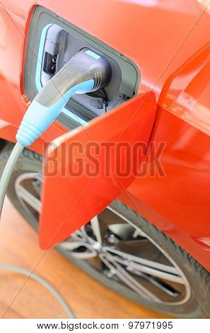 Modern Car With Eco Friendly Electric Engine At Charging Station