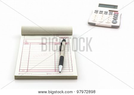 Invoice Book Which Open Blank Page With Pen And Calculato.