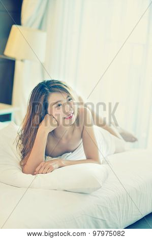 Smile Beautiful Young Woman In White Bathrobe In Bedroom At Home