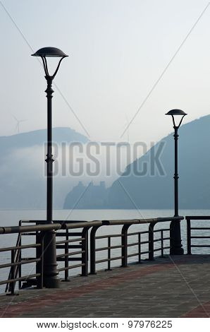 Danube river promenade at city of Golubac,old fortress in a mist