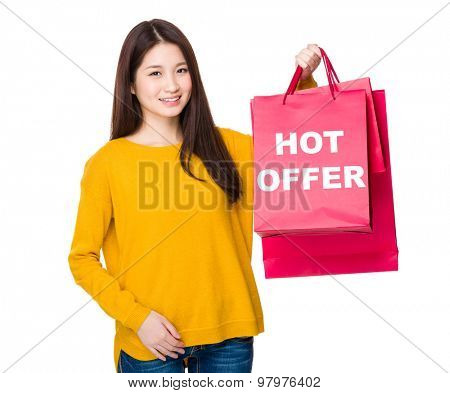 Woman hold with shoppong bag showing hot offer