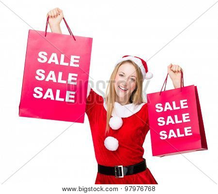 Woman with christmas party dress hold up with shopping bag and showing three sale word