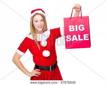 Christmas party dressing girl with shopping bag showing big sale