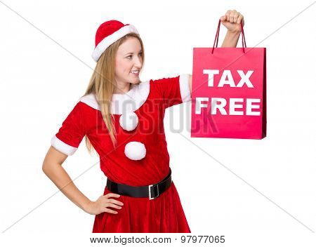 Christmas woman hold with shopping bag showing tax free