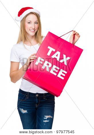 Woman with red shopping bag and showing tax free