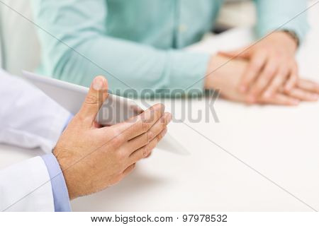 medicine, health care, people, prostate cancer and technology concept - close up of f male doctor and patient hands with tablet pc computer