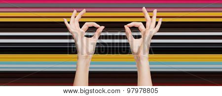 gesture, people and body parts concept - woman hands showing ok sign over blue sky and clouds background