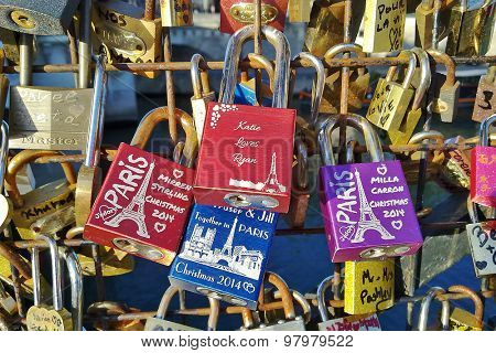 PARIS, FRANCE - JULY 29, 2015: Lockers on the bridge. Hanging lockers on bridges is popular romantic tradition among loving couples visiting Paris.