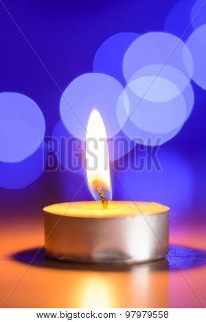 Tea Candle And A Blue Bokeh
