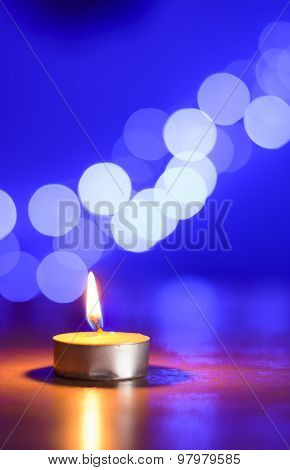 Tea Candle And A Bleu Bokeh