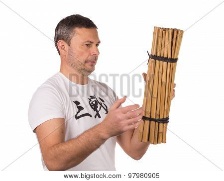 Man throw bunch of bamboo.