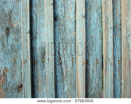 Fragment Of An Old Wooden Fence Made Of Boards