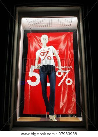 Female Mannequin In The Window Behind The Glass