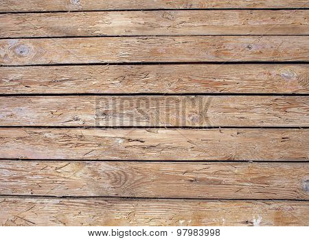 Fragment Of An Old Wooden Fence Made Of Unpainted Boards