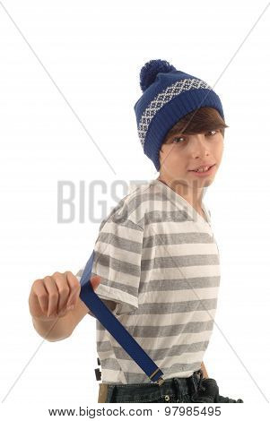 Teenage boy with cap and suspenders on white background