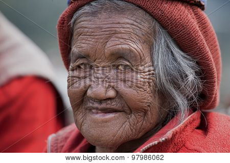 Ifugao Woman In National Dress Next To Rice Terraces In Banaue, Philippines.