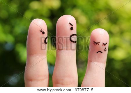 Finger art of family during quarrel. The concept of parents scolded her daughter, she was crying.