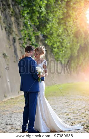 Beautiful Wedding Couple Near Stone Wall