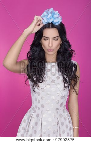 Beautiful women in pink background with present. Party. Love. Gift.