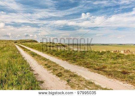 ranch road over prairie in eastern Kansas near Castle Rock, summer scenery,