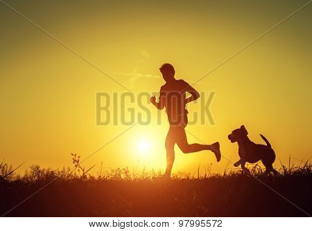 Runner on the distance with his faithful four-legged friend