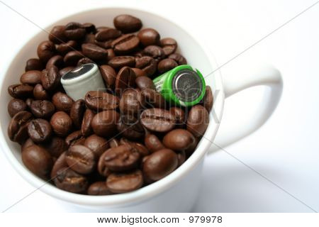 Two Batteries And Cup With Grains Of Coffee